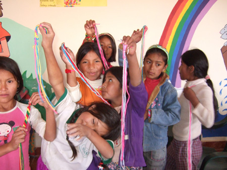 children showing their new friendship braclets